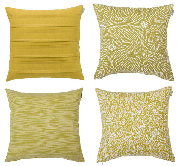 Set of 4 matching cushion covers in mustard yellow